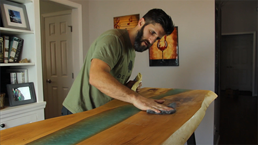 Craig DeCicco works on one of his many live-edge furniture pieces for a client.
