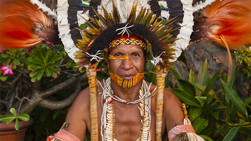 A new headdress is worn in the traditional style.