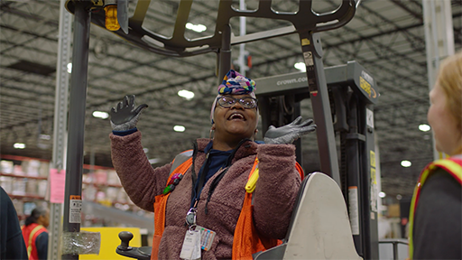 women are celebrated in the workplace at an Amazon warehouse.