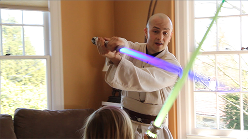 Jedi Andy walks a child through a simple lightsaber training sequence.