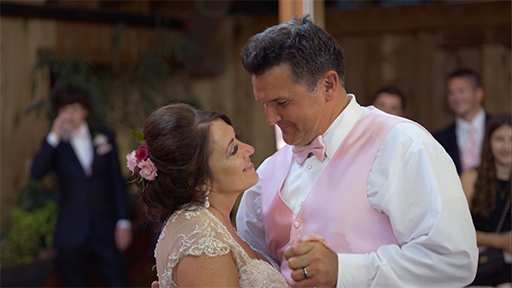 Kim and Dave dance at their Summer 2018 wedding reception.