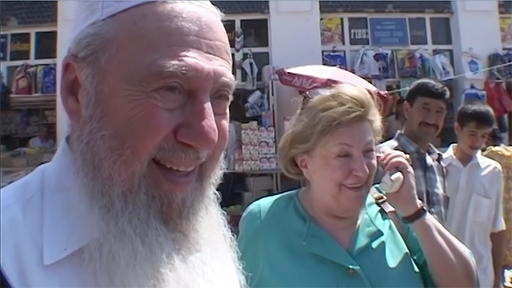 Mr. and Mrs. Scharf are greeted with enormous generosity by strangers in the marketplace of Samarkand.