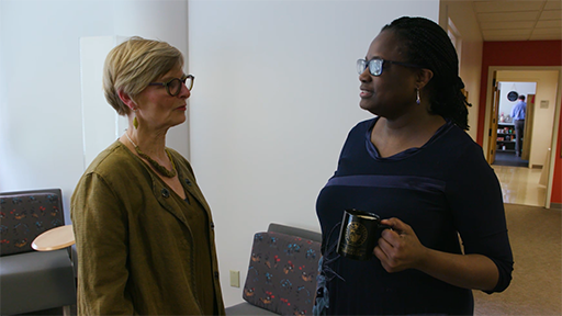 Deanna Sands, the Dean of SU's College of Education, chats with Dr. Colette Taylor, one of the COE faculty members.