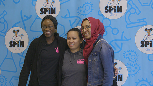 Three women that were part of the SPIN Girls presentation day pose for a photograph.
